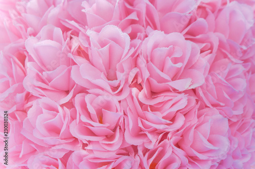 Close up light pink artificial fabric roses group for texture or background - 230030324
