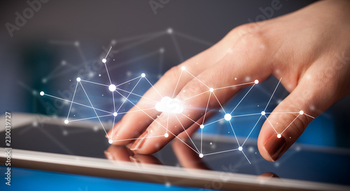 Leinwanddruck Bild Female hands touching tablet with white cloud concept