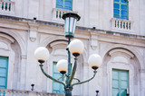 Old street lamppost – vintage light on streets in Catania, Sicily, Italy - 230047335