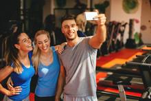 """Постер, картина, фотообои """"Friends making selfie in the gym"""""""
