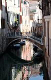 Scenic bridge over small canal in Venice - 230052343