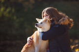 Young woman on a walk with her dog breed Akita inu - 230053509