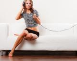 woman in headphones listening music mp3 relaxing - 230053970