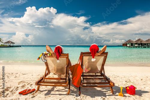 Couple on a beach at christmas - 230054981