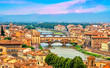 Leinwanddruck Bild - Aerial view of medieval stone bridge Ponte Vecchio over Arno river in Florence, Tuscany, Italy. Florence cityscape. Florence architecture and landmark.