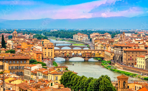 Leinwanddruck Bild Aerial view of medieval stone bridge Ponte Vecchio over Arno river in Florence, Tuscany, Italy. Florence cityscape. Florence architecture and landmark.