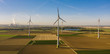 Wind turbine with coal power plant view from drone - environment friendly, renewable energy concept - copyspace for your individual text
