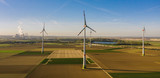 Wind turbine with coal power plant view from drone - environment friendly, renewable energy concept - copyspace for your individual text - 230082939