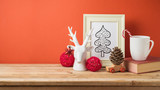 Christmas holiday background with cup, book, drawing and decorations on wooden table - 230108732
