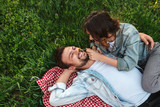 Woman tickling face of boyfriend in nature - 230118705