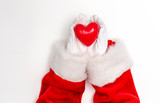 Santa holding a heart on a white background - 230141928