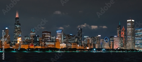 Downtown Chicago cityscape skyline at night with Lake Michigan in the foreground - 230142724