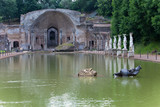 Ancient Pool Canopus, surrounded by greek sculptures in Hadrian's Villa (Villa Adriana, 2nd century AD), Tivoli, Italy.UNESCO World Heritage Site. - 230177953