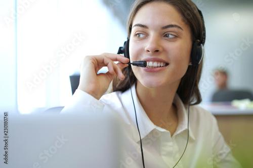 Leinwanddruck Bild Customer support operator working in a call center office.
