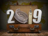2019 Happy new year. Vintage suitcase with number 2019 as Coloisseum and Big Ben tower. Travel and tourism concept. - 230191327