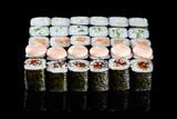 Traditional japanese sushi on a black background. © sergeyklopotov