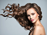 Face of a beautiful  woman with long flying   hair - 230195112
