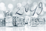 2019 new year card, Small Christmas gifts in shiny silver paper, bokeh lights background - 230210139