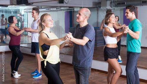 Glad adults dancing bachata - 230217552