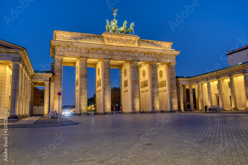 Leinwandbild Motiv The famous illuminated Brandenburger Tor in Berlin at dawn