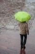 Leinwandbild Motiv Mulhouse - France - 28 October 2018 - portrait of man walking with green umbrella on cobbles place