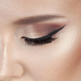 Eye of luxurious young woman with perfect make-up