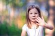 Happy little girl outdoors close up portrait