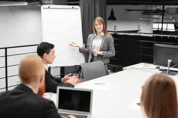 Office employees having meeting in conference room