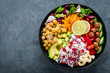 Leinwandbild Motiv Healthy vegetarian Buddha bowl with fresh vegetable salad, rice, chickpea, avocado, sweet pepper, cucumber, carrot, pomegranate and nuts closeup