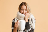 Portrait of a smiling girl dressed in sweater and scarf - 230282141