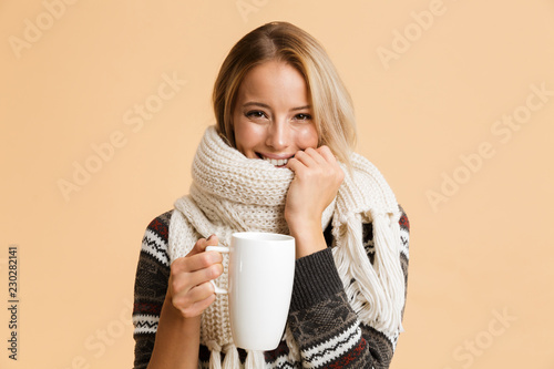 Leinwanddruck Bild Portrait of a smiling girl dressed in sweater and scarf