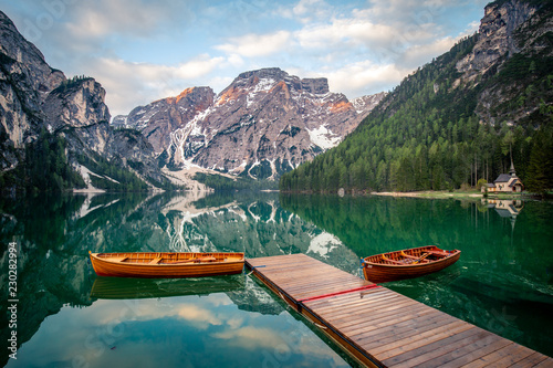 The Pragser Wildsee, or Lake Prags, Lake Braies one of the most famous lakes in the world. Lake is located in dolomite of italy  - 230282994