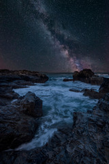 Vibrant Milky Way composite image over landscape of Cornwall coastline in England © veneratio
