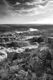 Stunning Autumn sunset landscape image of view from Leather Tor towards Burrator Reservoir in Dartmoor National Park in black and white