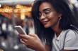 Checking messages. Side view portrait of hipster young lady holding mobile phone and smiling
