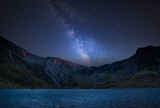 Digital composite Milky Way image of Beautiful landscape image of Llyn Idwal and Devil's Kitchen in Snowdoina - 230286950
