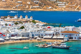 Mykonos port with boats and windmills, Cyclades islands, Greece - 230289795