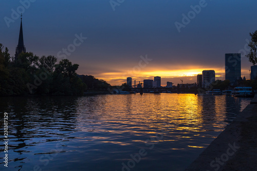 frankfurt and the main river cityscape in the sundown - 230307329