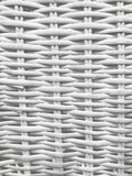 White wicker background and woven pattern texture.