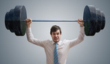 Young businessman in shirt is lifting heavy weights. - 230324348