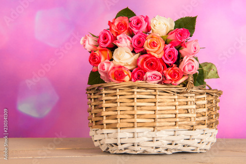 Basket colorful mixed roses in interior