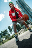 Basketball training. Nice professional player holding a ball while training to play basketball