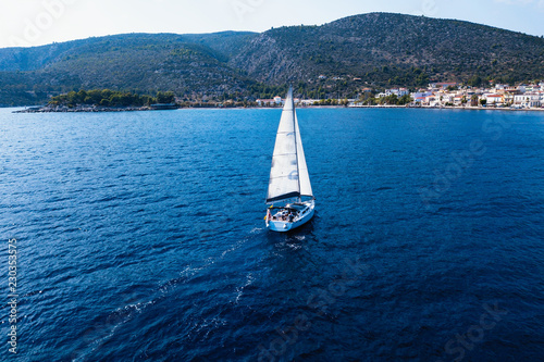 Sailing yacht boat at the Sea. Regatta and luxury cruise yachting along Greece coasts.