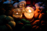 knitted pumpkin with candles in night - 230354366