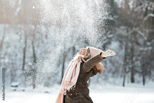 Beautiful young woman enjoying in the snow © Tijana
