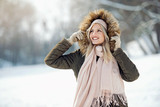 Fototapety Beautiful young woman enjoying in the snow