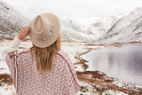 Woman traveler on the background of a beautiful mountain lake - 230363114