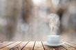 Leinwandbild Motiv hot coffee on the table on a winter background