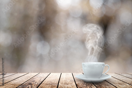 Poster hot coffee on the table on a winter background
