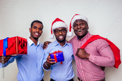 African American Men In Santa Hat With Gift Box On White Background